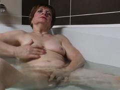 Horny grandma masturbating in the bath